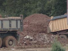 Heavy duty trucks. Truck dumps ground. Construction industry. Stock Footage