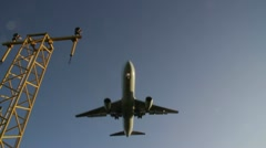Low angle as plane comes in land Stock Footage