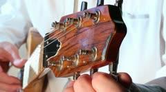 Tuning custom electric rock guitar Stock Footage