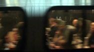 Stock Video Footage of Train passengers traveling - see through window, leaving station