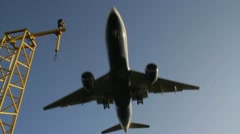 Low angle as plane comes in land - stock footage