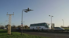 Aircraft landing over a busy road Stock Footage