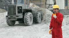 Bulldozer and Factory Worker - stock footage