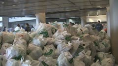 Stock Footage - American Economics - A mountain of food to be donated Stock Footage