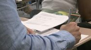 Stock Video Footage of Students writing in their notebook in classroom (1 of 3)