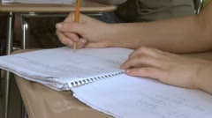 Students writing in their notebook in classroom (2 of 3) - stock footage