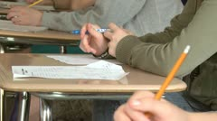 Junior high students writing in class (2 of 6) - stock footage