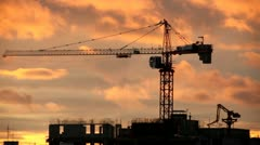 Sunrise Time Lapse With Under Construction Building In Fore Ground - stock footage