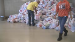 Stock Footage - American Economics - Workers moving donated food for needy. - stock footage