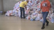 Stock Footage - American Economics - Workers moving donated food for needy. Stock Footage