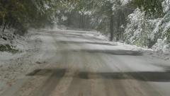 Driving car on winter road Stock Footage