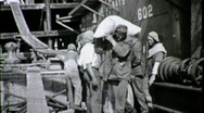 Stock Video Footage of Longshoremen Dock Workers UNLOAD CARGO 1930s (Vintage Film 8mm Home Movie) 1650