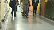 Stock Video Footage of Junior High students walking down hall by lockers (1 of 7)