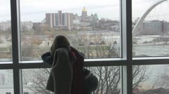 Stock Video Footage of Stock Footage - Young girl looking out at the Des Moines City View