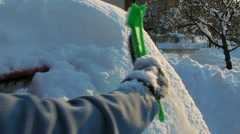 HD: Cleaning The Snow Of Car's Back Window Stock Footage