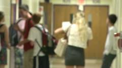 Junior high students standing in hallway - stock footage