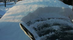 HD: Cleaning The Snow Of Car's Front Window Stock Footage