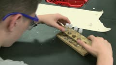 Student working on lab project in Science class (4 of 12) Stock Footage