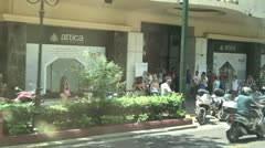 City street traffic, pedestrians and stores in modern Athens, Greece Stock Footage