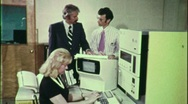 Stock Video Footage of OFFICE STAFF IBM RETRO COMPUTER Data 1970s Vintage Film Industrial Movie 1662