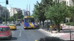 City street traffic & pedestrians in modern Athens, Greece Stock Footage