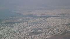 Aerial of Athens, Greece (looking from the southern suburbs in foreground) Stock Footage
