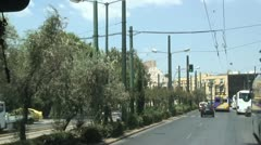 Athens, Greece street scene with Acropolis in distance. Stock Footage