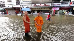 Two Buddhist monks in flood Stock Footage