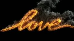 Writing word LOVE with fire Stock Footage