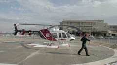 Helicopter AirMed pilot preparing aircraft for takeoff fast TL P HD 8514 Stock Footage