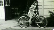 Happy Girl with Curls Rides Bike Bicycle 1930s Vintage Film Home Movie 1665 Stock Footage