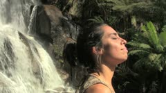 Woman and Tropical Waterfall Stock Footage