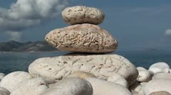 Stones, sea, island, sky, clouds Stock Footage