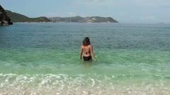 A girl entering the sea Stock Footage