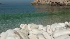 Peaceful view to the sea from the pebble beach Stock Footage