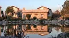 Stone house at lake Stock Footage