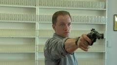 Desperate Man Points Gun at Camera and Warns Stock Footage