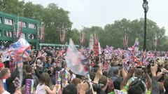 Large crowd cheer and wave flags for the Royal Wedding Stock Footage