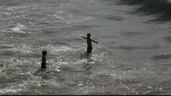 Kids are playing in the ocean Stock Footage