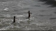 Stock Video Footage of Kids are playing in the ocean