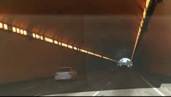 Driving through freeway tunnel during traffic in Los Angeles, California Stock Footage