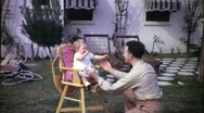 Stock Video Footage of Father Plays with Baby Daughter Circa 1955 (Vintage Film Home Movie) 1698