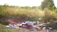 Stock Video Footage of Garbage in field. Illegal dumping