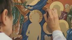 Orthodox icon. Iconography. The icon painter at work in the icon workshop. Stock Footage