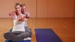 Women in fitness center holding thumbs up Stock Footage