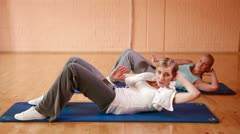 Women doing crunches in gym Stock Footage