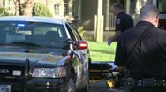 Police officer writes report after an accident Stock Footage