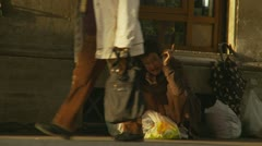 Mental homeless person abandoned on the street Stock Footage