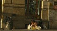 Tourists walk pass homeless lady Stock Footage