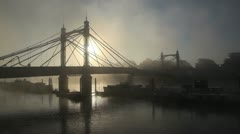 Albert Bridge London in the fog wide shot with crane Stock Footage
